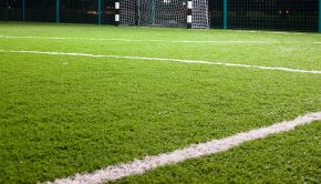 Soccer field with green grass in the night